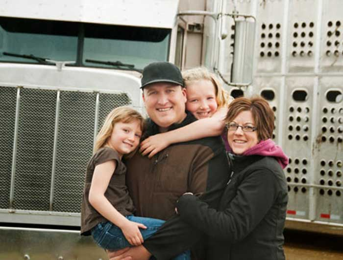Comercial truck driver and his family.