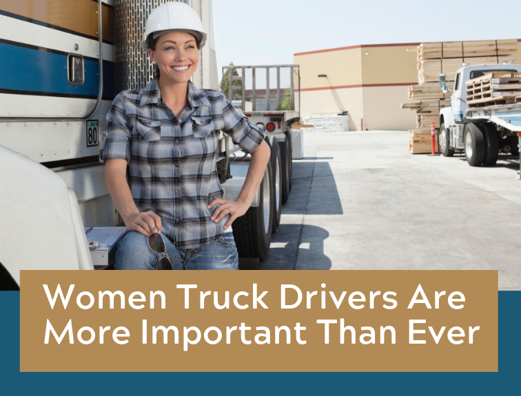 A woman truck driver standing next to a truck.