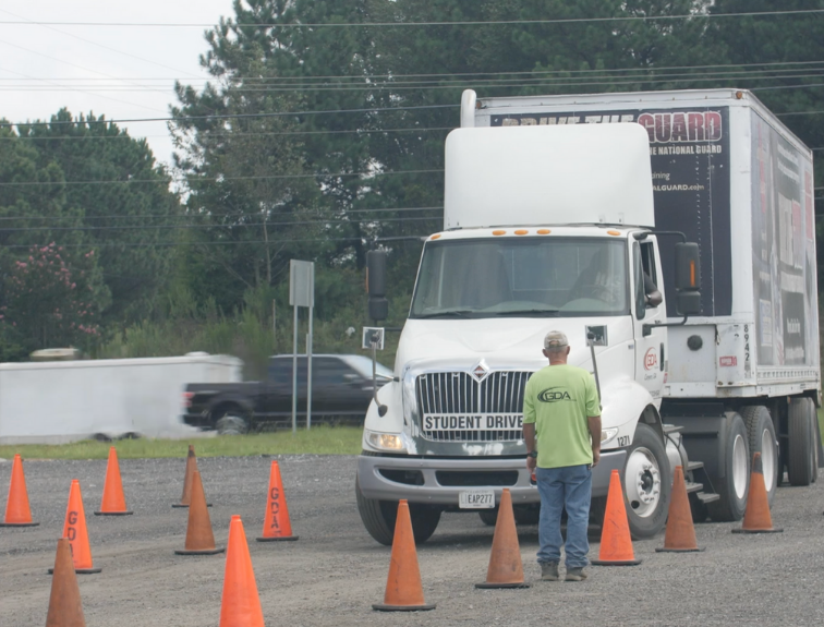 gda instructor teaching student driver with cones set up